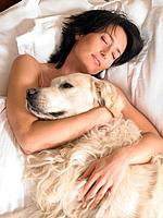 Woman with dog laying