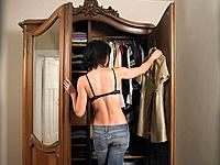 Woman in bra, choosing her outfit