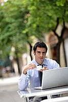Business man at café with laptop