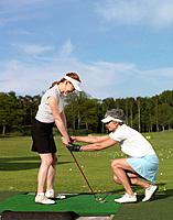 Two women at driving range (thumbnail)