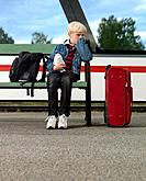 Boy waiting on train station