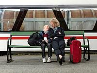 Grandmother and grandson on train station