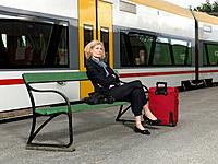 Mature woman on train station