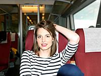 Woman on train (thumbnail)