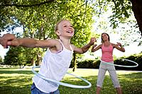 Mother and daughter with hula-hoop (thumbnail)