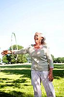Mature woman with hula_hoop