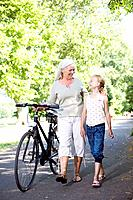 Grandmother with granddaughter and bike (thumbnail)