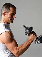 Mature man with hand weights