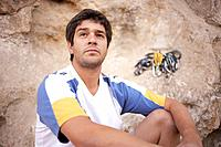 Argentinean rock climber looking pensive