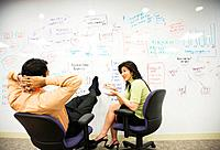 Multi_ethnic business people brainstorming on whiteboard
