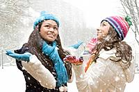 Multi_ethnic girls looking up in snow