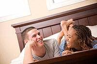 Multi_ethnic couple laying in bed