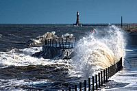 Waves crashing by lighthouse at Sunderland, Tyne and Wear, England