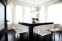 Plush upholstered chairs around contemporary dining table