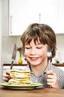 Boy looking at pancakes