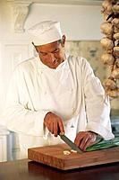 Chef chopping scallions