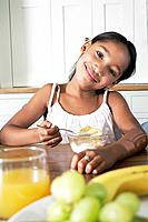 Young girl having breakfast