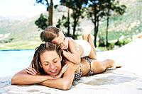 Mother and daughter by a pool