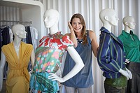 Woman standing with mannequins