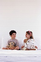 Boy and girl sitting in bed