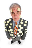 Senior business man covered with adhesive notes, portrait