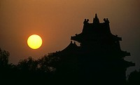 China, Beijing, silhouette of forbidden palace guard tower, dusk