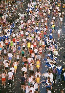 High angle view of marathon runners on First Avenue, New York city. Volunteers handing out cups of water. New York, USA.