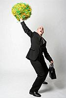 Business man waving pompom, studio shot