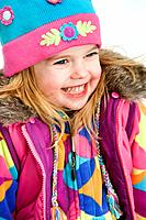 Portrait of little girl wearing winter coat and hat