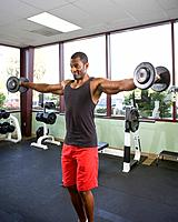 Male athlete lifting weights in gym