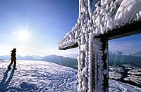 cross on summit of Schlenken with rime ice, view to Berchtesgaden range, Salzkammergut, Salzburg, Austria