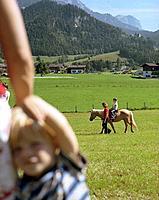 Horseriding, alp meadow, near Leogang, Salzburg, Austria