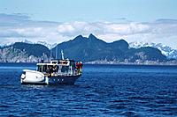A tourist boat at Kenai Fjords National Park, Mountains, Alaska, USA