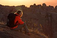 A female hiker having a rest in Andringitra National Park, Madagascar, Africa