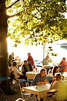Guests sitting in a beer garden, Restaurant Woerl, Lake Woerthsee, Bavaria, Germany