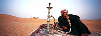 Bedouin with waterpipe, Desert, Dubai, UAE