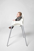 A baby in a high chair