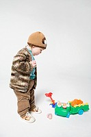 A boy looking at toys (thumbnail)