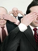Businessmen covering eyes (thumbnail)