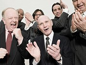 Businessmen clapping