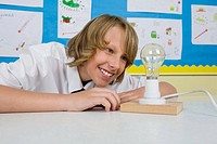 Boy looking at lightbulb