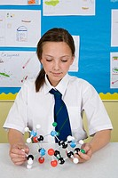 Girl with molecule model