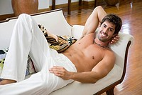 Smiling man relaxing on a sofa