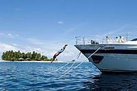 Man diving from a yacht, Luxury vacation on a private island with yacht, Rania Experience, Faafu Atoll, Maldives