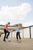 Teenage boys playing football
