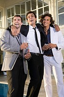 Three male friends laughing