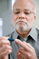 A man doing a home blood glucose testing