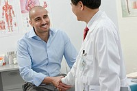 A doctor and patient shaking hands