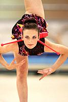 Girl performing rhythmic gymnastics with clubs