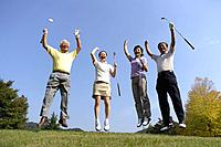 Victorious golfers jumping with raised arms